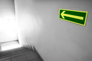 Photoluminescent sign-arrow pointing direction of exit