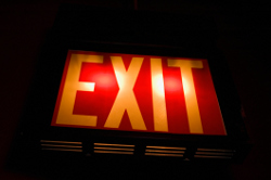 Exit sign with bulb and battery backup